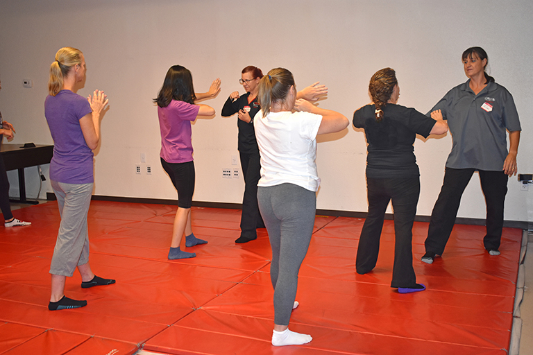 "alt=""Women participating in a self defense training course"""