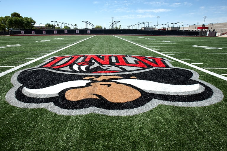 UNLV logo on football practice field