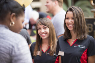 Two females with Lee Business School shirts on.