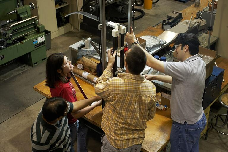 Engineering students work on a project