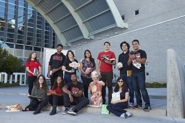 Students pose in front of the Lied Library entrance