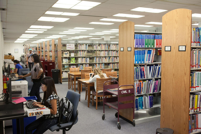 Students access computer kiosks at the Teacher Development Resources Library.